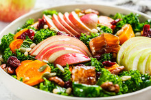 Winter Salad With Apple, Pumpkin, Cranberries, Honey And Seeds In White Plate. Healthy Vegan Food Concept.