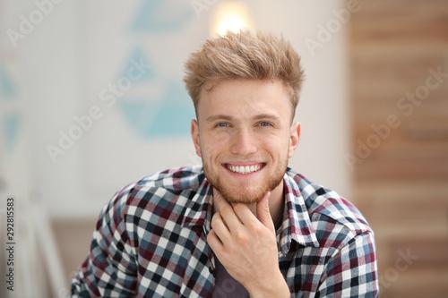 Fotografie, Obraz Portrait of handsome young man in room
