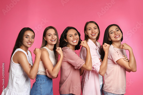 Happy women posing on pink background. Girl power concept - 292816996
