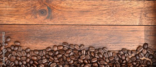 Photo sur Aluminium Café en grains Close up of coffee beans on wooden background
