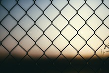 Metallic Fence With The Background Blurred