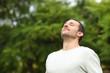 Leinwanddruck Bild - Relaxed adult man breathing fresh air in a forest