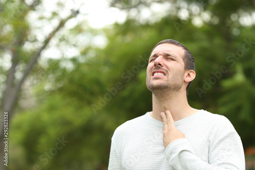 Fototapety, obrazy: Man suffering throat ache complaining in a park