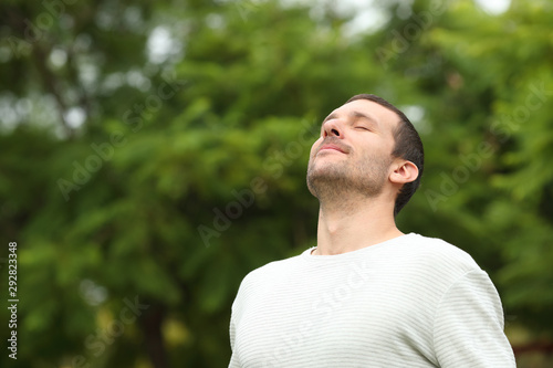Fototapety, obrazy: Relaxed adult man breathing fresh air in a forest