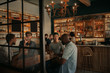 canvas print picture - Diverse group of guys talking over drinks in a bar
