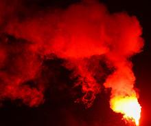 Red Smoke Burns At Night As A ...