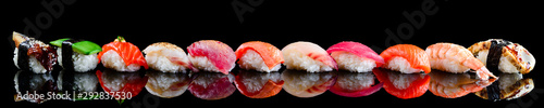 Photo Stands Sushi bar sushi set nigiri on a black background