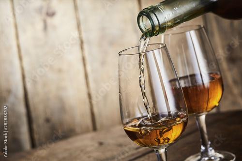 Sherry being poured into an elegant glass Fototapeta
