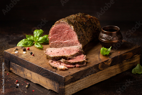 Juicy roast beef with spices sliced on a cutting Board, delicious meat, traditional food Fototapet