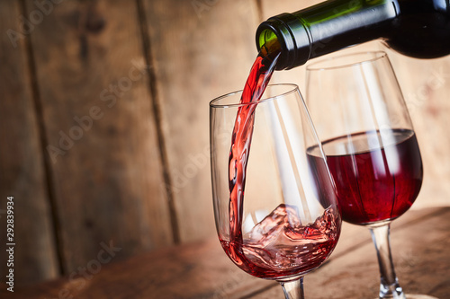Pouring two glasses of fortified red port wine - 292839934
