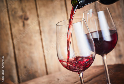 Fotomural Serving two glasses of red wine with copy space