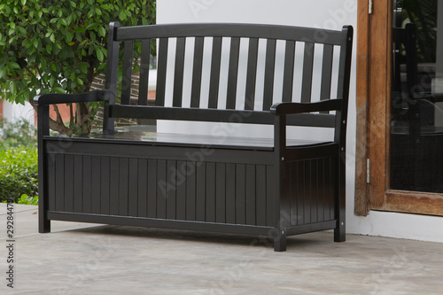 The storage bench in the backyard. Canvas Print
