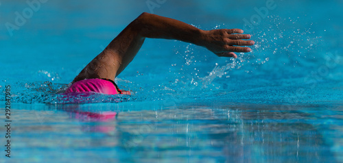 Swim competition swimmer athlete doing crawl stroke in swimming pool Wallpaper Mural