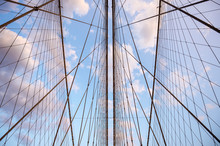 Close-up Abstract View Of Criss-crossed Steel Suspension Cables Of The Brooklyn Bridge Under Scenic Sunset Skies