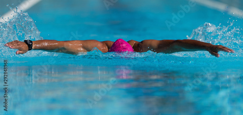 Tableau sur Toile Swim competition swimmer athlete doing butterfly stroke in swimming pool