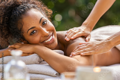 obraz PCV Black woman relaxing during spa massage