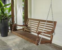 The Brown Wood Swing In The Backyard.