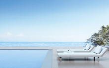 View Of Daybed With Side Table And Wood Terrace On Sea View Background,Blue Pool. 3D Rendering