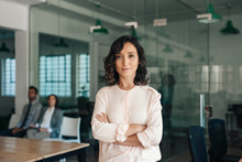 Young Businesswoman Standing C...