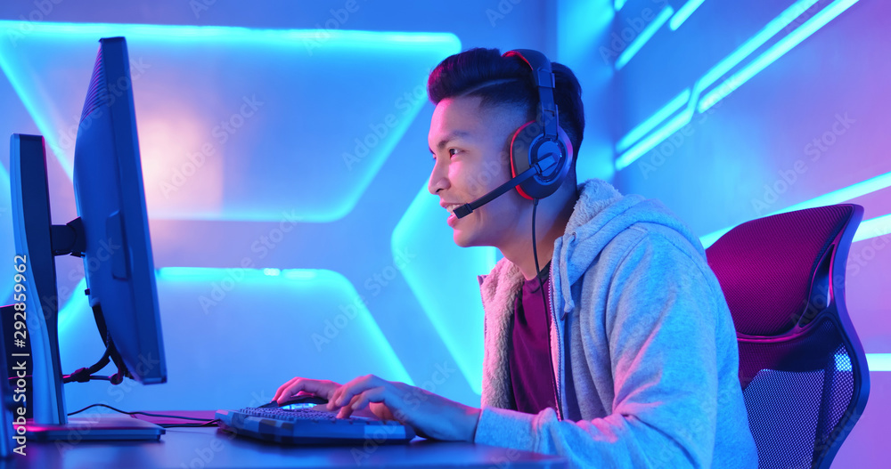 Fototapeta Young Asian cyber sport gamer