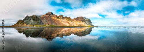 Splendid sunny day and gorgeous reflection of Vestrahorn mountaine on Stokksnes cape in Iceland.