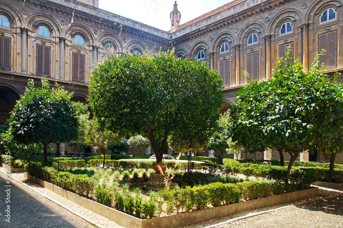 Fotografie, Obraz A well-kept green courtyard with trees and a fountain in the Doria Pamphili Gall