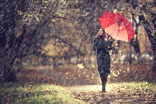 October Walk In The Rain, A Young Woman With A Red Umbrella In The Autumn City Park, Autumn Look
