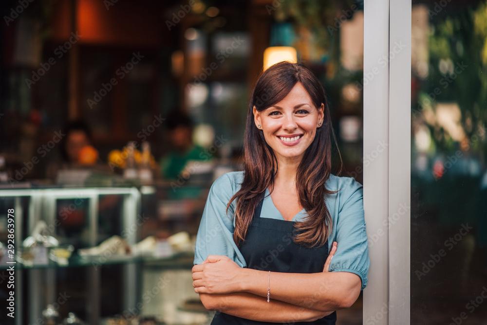 Fototapeta Portrait of a beautiful smiling female small business owner.