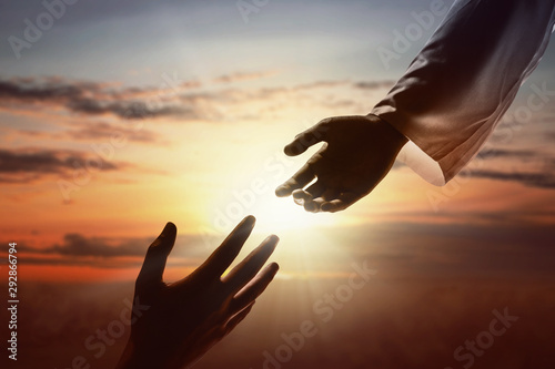Fotografia Jesus Christ giving a helping hand to human
