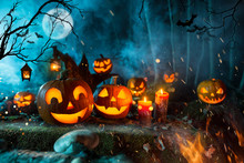 Halloween Pumpkins On Dark Spo...