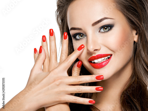 beautiful-smiling-woman-with-red-nails