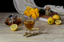 Useful Herbal Tea With A Plant (Sideritis Scardica) And Lemons Close-up