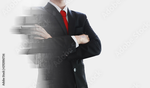Fotografie, Obraz Double exposure, Businessman and buildings with red necktie and arm crossed