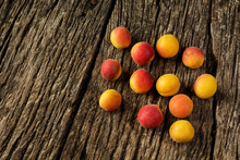 Apricots On A Dark Rustic Wooden Background. Copy Space For Text.