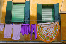 Colorful Clothes Hanging On A Clothesline From A Window To Dry In The Sun In Venice, Italy