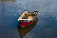 A Worn Red Wooden Rowing Boat ...