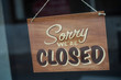 Closeup of wooden panel on store front : Sorry we are closed