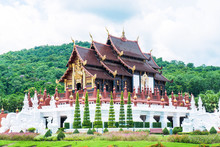 Closeup Of Royal Pavilion At Royal Park Rajapruek In Chiang Mai Province,Thailand. Chiangmai Royal  Pavilion ( Ho Kham Luang ) Architecture With Tree And Blue Sky Background