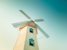 Windmill On Background Of Blue...