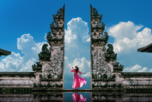 Young Woman Standing In Temple...