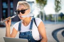 Modern Woman Smoking E-cigaret...