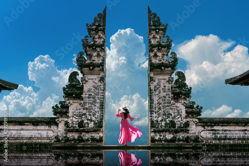 Young woman standing in temple gates at Lempuyang Luhur temple in Bali, Indonesia Canvas Print