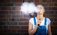 Modern Girl Outdoor Smoking Va...