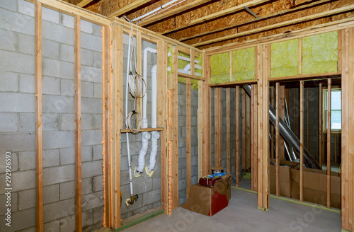 New residential construction home framing with basement view Canvas Print