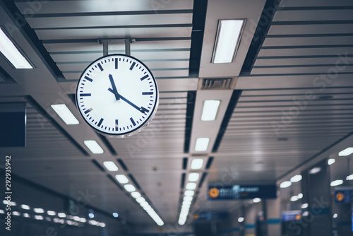 Public clock in subway station at train station for watch time waiting train Poster Mural XXL