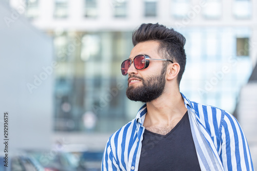 obraz PCV Portrait of handsome confidence man with a beard outdoors