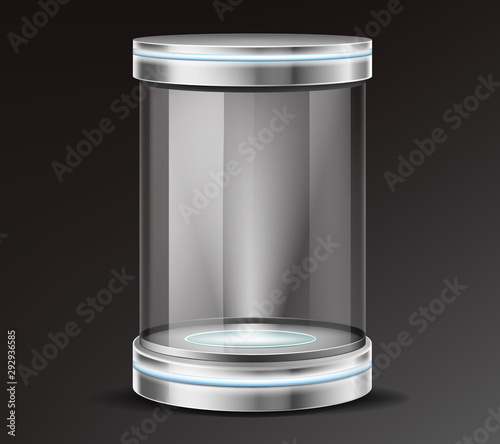 Fotografía  Empty glass cylinder capsule, transparent round showcase with neon illumination in metal base, lid