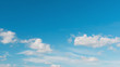 Blue sky background with cumulus clouds