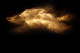Fototapeta Kamienie - Brown dry river sand explosion isolated on black background. Abstract sand splash.