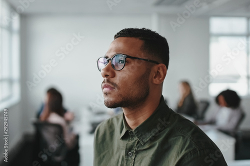 Close-up of a young african american business man entrepreneur wearing eyeglasse Fototapet